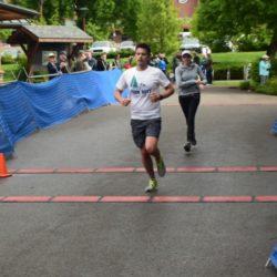 Male Runner Athlete Crossing Finish Line