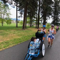 Two Runner Athletes Racing with Female Rider Athlete
