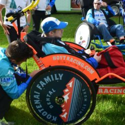 Team Member Assisting Rider Athlete in Kootenai Family Dental Race Chair