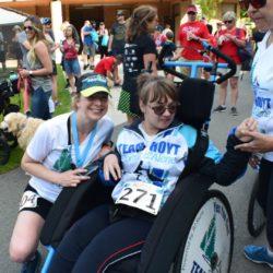 Runner Athlete Posing Near Female Rider Athlete