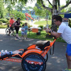 Male Runner Athlete Pushing Rider Athlete in Kootenai Family Dental Chair