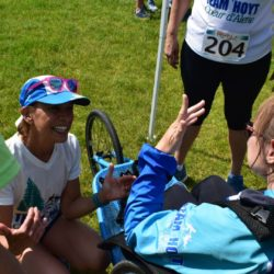 Female Runner Athlete Smiling near Female Rider Athlete at McEuen Park