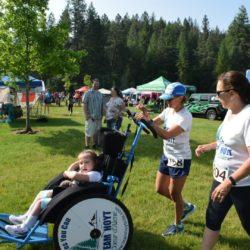 Runner Athletes Pushing Rider Athlete