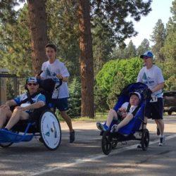 Two Runner Athletes Pushing Rider Athletes
