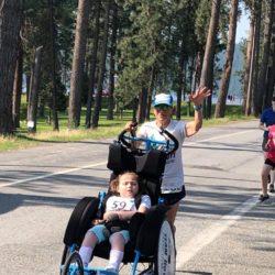 Female Runner Athlete Pushing Rider Athlete in Race for #271
