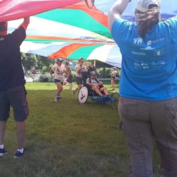 Runner Athlete and Rider Athlete Going Through Tent in McEuen Park
