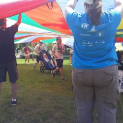 Runner and Rider Athlete Crossing Through Tent at Run for #271