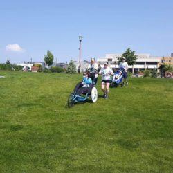 Team Mates Standing In Grass Field