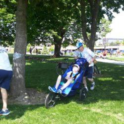 Team Mates Gathering Around Tree in McEuen Park