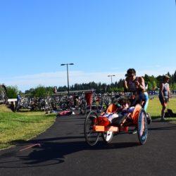 Team Mate Pushing Rider Athlete During Race