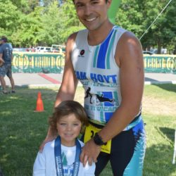 Male Runner Athlete Posing with Child