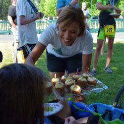 Female Runner Athlete Holding Food