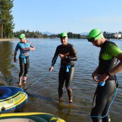 Three Swimmer Athletes Posing