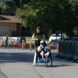 Male Runner Athlete Pushing Male Rider Athlete