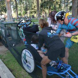 Runner Athletes Assisting Rider Athlete
