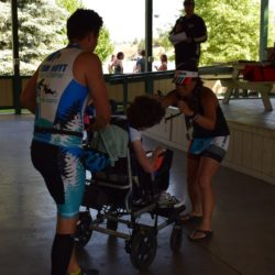 Runner Athletes Standing Near Rider Athlete