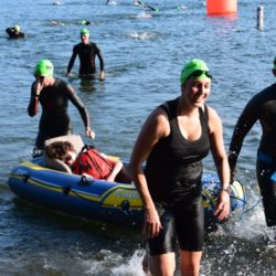 Runner Athletes Pulling Rider Athletes in Water Raft