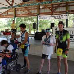 Runner and Rider Athletes Presented with Medals Posing for Photo