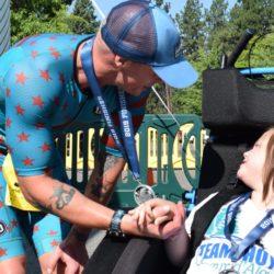 Runner Athlete Kneeling Down Near Female Rider Athlete