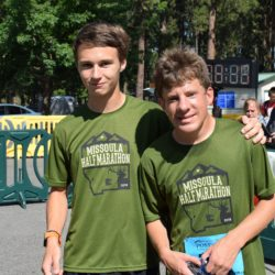 Two Male Runner Athletes Posing for Photo