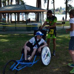 Runner Athlete Standing Behind Rider Athlete