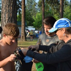 Team Members Assisting Swimmer Athlete