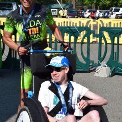 Male Runner Athlete Standing Behind Male Rider Athlete
