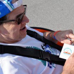 Runner Athlete Looking at Race Badge