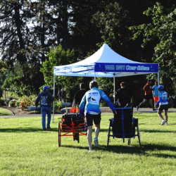 Runner Athlete Pulling Two Riding Chairs to Team Tent