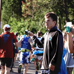 Team Hoyt Coeur d'Alene Volunteer Ringing Bell after Race Start