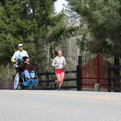 Runner Athletes Racing with Rider Athlete